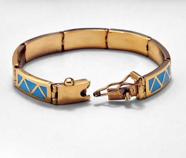 a view of the clasp on a gold and turquoise bracelet