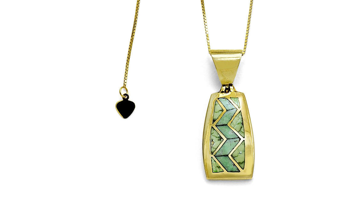 Gold pendant with turquoise inlay, heart pull on chain end.