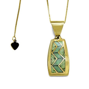 Heavy gold pendant with inlay