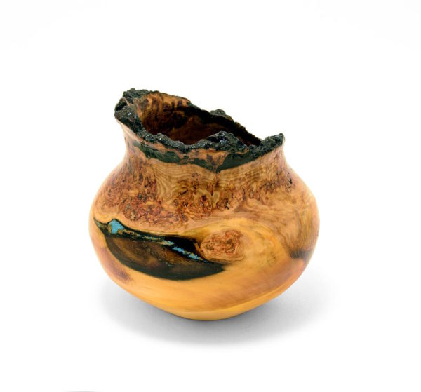decorative burl wood turning featuring irregular knotty wood and turquoise inlay