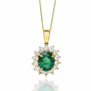 Gold pendant with emerald and diamonds