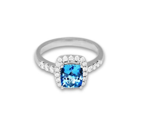 Ring with an aquamarine stone in a cluster of diamondss