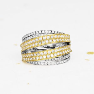 Womens diamond ring in white and yellow gold.