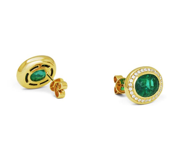 Yellow gold earrings featuring diamonds and emerald gemstones